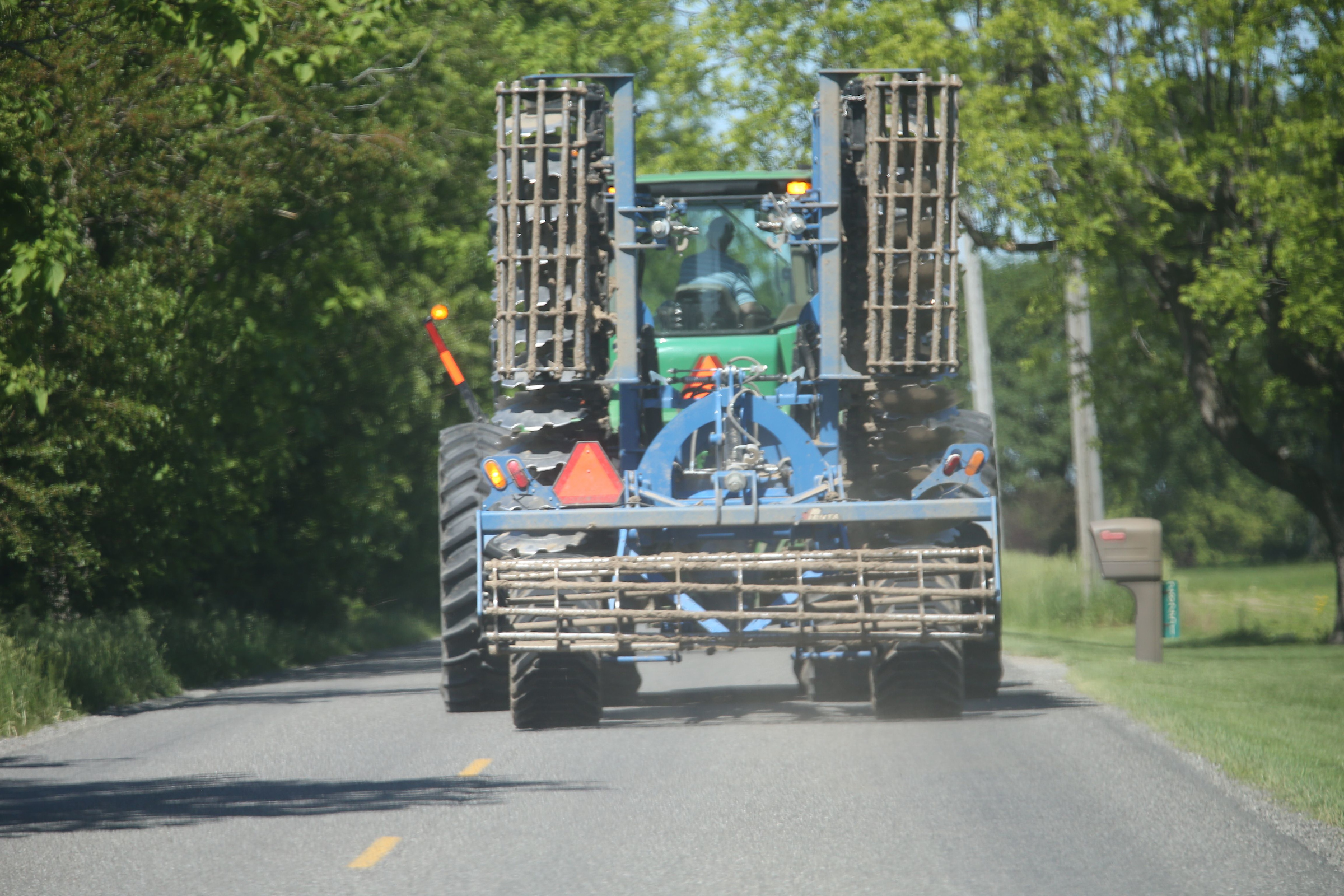 Farm Safety - 06/02/2017 - photos of a farm implement driving down a narrow road.